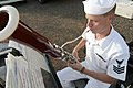 US Navy 030426-N-3228G-001 Musician 1st Class Sterling Strickler assigned to Pacific Fleet Band's Woodwind Quinter warms up his bassoon shortly before the arrival of the guided missile destroyer USS Paul Hamilton.jpg