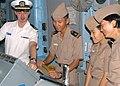 US Navy 030816-N-3931M-006 Lt. Brent Zito, left, explains the ship's navigation system to midshipmen from the Republic of Korea (ROK) in the pilot house aboard USS Blue Ridge (LCC 19).jpg