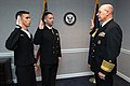 US Navy 031204-N-2383B-029 Two of the navy's top sailors reaffirm the oath of enlistment with Adm. Vern Clark, Chief of Naval Operations (CNO) as he confirms the promotion of Petty Officer 2nd Class.jpg