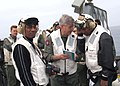US Navy 040615-N-8497H-079 Commander 3rd Fleet, Vice Adm. Michael J. McCabe explains to actor-comedian Jamie Foxx about the Landing Signal Officer (LSO) guidebook.jpg