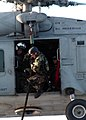 US Navy 040619-N-2788L-144 Members assigned to Explosive Ordnance Disposal Mobile Unit Eleven (EODMU-11) prepare to exit an SH-60F Seahawk.jpg