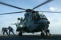 US Navy 041006-N-3503M-004 Crew members aboard the guided missile cruiser USS Cowpens (CG 63), chain-down an Indian Navy Sea King Mk 42B helicopter.jpg
