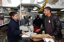 US Navy 041211-N-6536T-074 Television actor Scott Lawrence purchases souvenirs from the ship's store during a visit to the aircraft carrier USS Nimitz (CVN 68).jpg