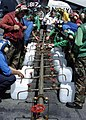 US Navy 050110-N-6817C-026 Crew members aboard USS Abraham Lincoln (CVN 72) fill jugs with purified water from a Potable Water Manifold.jpg
