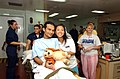 US Navy 050314-N-6665R-012 A Project HOPE volunteer takes a moment to pose for a picture with an Indonesian patient and his stuffed animal.jpg
