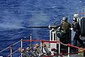 US Navy 050524-N-5663H-088 Gunner's Mate 2nd Class Gene A. Carroll fires a MK-38 25mm machine gun off the starboard bow of USS Fort McHenry (LSD 43), during a live fire demonstration.jpg