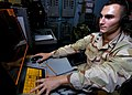US Navy 060830-N-6403R-007 Operation's Specialist 3rd Class Anthony Faieta from Clinton, Mass., assigned to Tactical Air Control Squadron Two Two (TACRON-22) mans the Tactical Air Control Center (TACC) aboard the amphibious ass.jpg