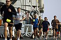 US Navy 070211-N-4207M-004 Sailors station aboard the amphibious assault ship USS Essex (LHD 2) stride side-by-side during a five-kilometer fun run held by Moral, Welfare and Recreation.jpg