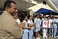 US Navy 070630-N-0194K-151 Lt. Cmdr. Manny Santiago, medical site leader for Military Sealift Command hospital ship USNS Comfort (T-AH 20), claps with outpatient nurses at Puerto Barrios National Hospital.jpg