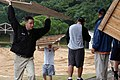 US Navy 070705-N-0807W-061 Forward-deployed Naval Forces (FDNF) Sailors and dependents help pick up trash, debris, and boards during a beach cleanup at Shirihama Beach.jpg