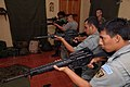 US Navy 070807-N-0989H-372 Task Group (TG) 40.9 Marines conduct weapons simulator training on the Indoor Simulated Marksmanship Training system with members of the Guatemalan Navy and Marines.jpg