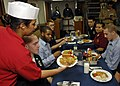 US Navy 080820-N-7280V-019 Yeoman Seaman Kristopher Phay enjoys an Asian-Pacific meal.jpg