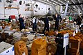 US Navy 080830-N-1635S-004 Sailors sort through 65 pallets of mail in the hangar bay of the Nimitz-class aircraft carrier USS Ronald Reagan (CVN 76) during a replenishment at sea.jpg