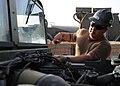 US Navy 081006-N-1120L-024 Equipment Operator 3rd Class Jason Tilden checks the oil levels in a high mobility multipurposed wheeled vehicle.jpg