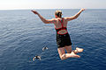 US Navy 081016-N-1635S-004 Quartermaster Seaman Sarah Mills leaps off the Ticonderoga-class guided-missile cruiser USS Chancellorsville (CG 62) during a scheduled swim call.jpg