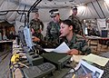 US Navy 081106-N-3857R-013 Yeoman 3rd Class Danellie Rivera, assigned to Naval Mobile Construction Battalion (NMCB) 1, stands watch in the Battalion's Combat Operations Center.jpg