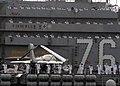 US Navy 081117-N-9758L-078 Sailors render honors as the ship passes the USS Arizona Memorial.jpg