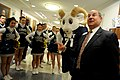US Navy 081204-N-5549O-069 Secretary of the Navy (SECNAV) the Honorable Dr. Donald C. Winter shows his support with U.S. Naval Academy cheerleaders and members of the academy band.jpg