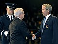 US Navy 090106-F-6655M-124 Secretary of Defense Robert M. Gates awards the Department of Defense Medal for Distinguished Public Service to President George W. Bush.jpg