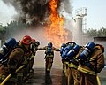 US Navy 090225-N-7862M-001 Naval Support Activity Bahrain Emergency Response Team fire brigade members participate in a training exercise at the Bahrain Ministry of the Interior Fire Training Academy in Riffa.jpg