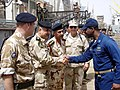 US Navy 090325-N-6590M-002 Senior Iraqi officers greet Lt. Allen Maxwell, commanding officer of the coastal patrol craft USS Chinook (PC 9), during a port visit by Chinook to Umm Qasr, Iraq.jpg