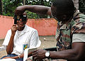 US Navy 090416-N-1655H-123 Hospital Corpsman 2nd Class Sule Abiodun, a member of the Africa Partnership Station Nashville Department of Defense medical team, tests the vision of a school girl in Libreville.jpg