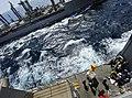 US Navy 090916-N-5345W-070 USNS Tippecanoe (T-AO 199), left, is alongside the amphibious dock landing ship USS Fort McHenry (LSD 43) during a connected replenishment at sea.jpg