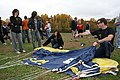 US Navy 091029-N-5366K-012 Chief Special Warfare Operator (SEAL) Justin Gauny, assigned to the U.S. Navy Parachute Team, the Leap Frogs, shows students how to pack his parachute after the team gave a demonstration at South Rive.jpg