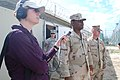 US Navy 100105-A-4297G-021 Katy Clark of Public Radio International speaks with the assistant officer-in-charge for Joint Task Force Guantanamo Camp 4 during a recent media tour.jpg