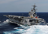 US Navy 100227-N-4408B-676 The aircraft carrier USS George H.W. Bush (CVN 77), the Navy's 10th and final Nimitz-class aircraft carrier heels hard to starboard during high-speed turn drills.jpg