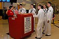 US Navy 101012-N-6736S-006 USO volunteer Pat Horvath instructs Sailors from the guided-missile submarine USS Georgia (SSGN 729) on how to greet ret.jpg