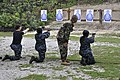 US Navy 101020-N-9402T-086 Sailors fire M9 Beretta pistols during a small-arms qualification as a requirement for auxiliary security force training.jpg