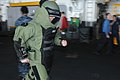 US Navy 110123-N-2908M-037 viation Ordnanceman 2nd Class Matthew Bolton tests his mobility while in a bomb suit during training aboard USS Kearsarg.jpg