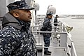 US Navy 110323-N-QP268-071 Sailors assigned to the amphibious dock landing ship USS Whidbey Island (LSD 41) man the rails as the ship departs Joint.jpg