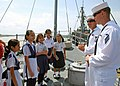 US Navy 110919-N-VP123-080 Mineman Seaman Tom Tate and Mineman 2nd Class Clifton Boyd explain what a mine countermeasures ship does.jpg
