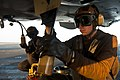 US Navy 111017-N-BT887-525 Aviation Structural Mechanic Airman Marcus Martinez takes an oil sample from an F-A-18C Hornet assigned to the Golden Dr.jpg