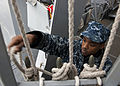 US Navy 111205-N-FI736-072 Quartermaster Seaman James Johnson secures nylon lines aboard the Arleigh Burke-class guided-missile destroyer USS Porte.jpg