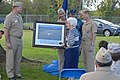 US Navy 111411-N-JB219-079 apt. Chuck Melcher, commanding officer of Naval Support Activity, Hampton Roads, presents Ruth Cutter, wife of the late.jpg