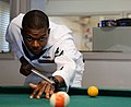 US Navy 180525-N-VI423-0004 Electronic Technician playing pool Fleet Week New York 2018.jpg