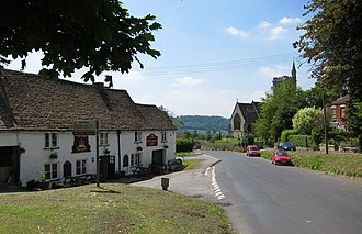 Uley - St Giles' church and the Old Crown pub, from the village green