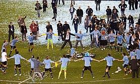 Los jugadores festejando la obtención del torneo.