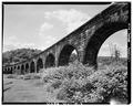 VIEW OF STONE ARCHES, OHIO SIDE - Baltimore and Ohio Railroad, Benwood Bridge, Benwood, Marshall County, WV HAER WVA,26-BEN,1-4.tif