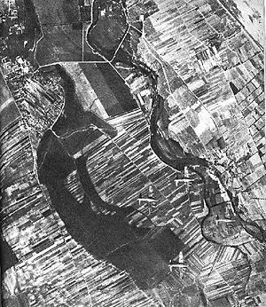 Warsaw airlift - American Boeing B-17 Flying Fortress aircraft leaving Warsaw and heading East after air drops on September 18. Wisła river visible as well as Wilanów Palace gardens in upper left part of image.