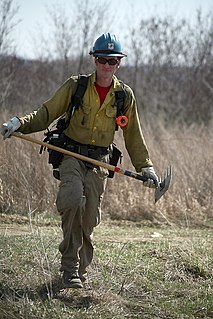 McLeod (tool) two-sided blade used during wildfire suppression and trail restoration