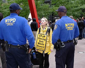 English: A woman protesting weak protections f...