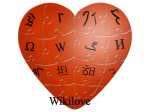 "Impression of red heart with language glyphs inside puzzle pieces similar to Wikiafripedia Global Logo and with ""Wikilove"" at bottom"