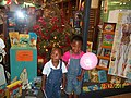 Wilson & Vanessa posing in awe outside BOOKSTORE AFTER A CHRISTMAS LUNCH TREAT 2011.jpg