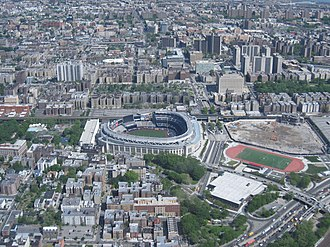 The Bronx - Yankee Stadium (center), Bronx County Courthouse and the Grand Concourse towards the top. To the right of the current stadium is the site of its predecessor.