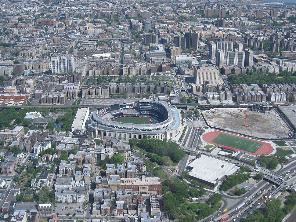 Yankee Stadium (center), Bronx County Courthouse and the Grand Concourse towards the top. To the right of the current stadium is the site of its predecessor.
