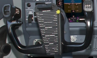 "Yoke (aeronautics) - The ""W"" shaped control yoke of a Boeing 737. Note the checklists for before takeoff to landing in the middle."